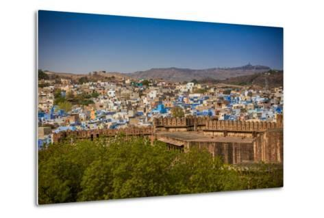The City Wall of Mehrangarh Fort Towering over the Blue Rooftops in Jodhpur, the Blue City-Laura Grier-Metal Print
