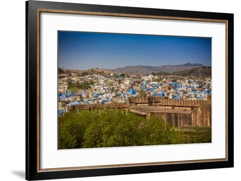 The City Wall of Mehrangarh Fort Towering over the Blue Rooftops in Jodhpur, the Blue City-Laura Grier-Framed Art Print