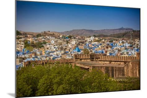 The City Wall of Mehrangarh Fort Towering over the Blue Rooftops in Jodhpur, the Blue City-Laura Grier-Mounted Photographic Print