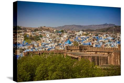 The City Wall of Mehrangarh Fort Towering over the Blue Rooftops in Jodhpur, the Blue City-Laura Grier-Stretched Canvas Print
