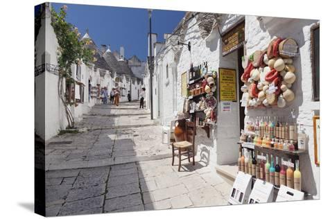 Souvenir Shop on Street of Trulli, Traditional Houses, Rione Monti Area-Markus Lange-Stretched Canvas Print