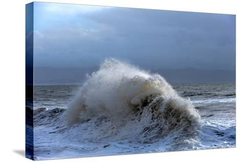 Huge Waves Crash Against a Stone Jetty at Criccieth, Gwynedd, Wales, United Kingdom, Europe-Graham Lawrence-Stretched Canvas Print