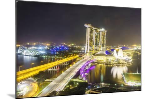 Busy Roads Leading to the Marina Bay Sands, Gardens by the Bay and Artscience Museum at Night-Fraser Hall-Mounted Photographic Print