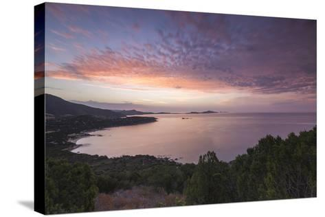 The Colors of Sunrise are Reflected on the Sea around the Beach of Solanas, Villasimius, Cagliari-Roberto Moiola-Stretched Canvas Print