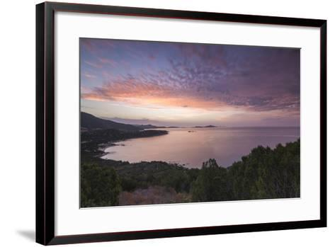 The Colors of Sunrise are Reflected on the Sea around the Beach of Solanas, Villasimius, Cagliari-Roberto Moiola-Framed Art Print