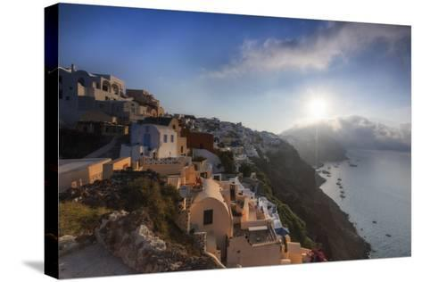 Sunbeam Through the Clouds over the Aegean Sea Seen from the Typical Village of Oia, Santorini-Roberto Moiola-Stretched Canvas Print