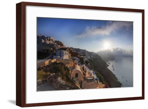 Sunbeam Through the Clouds over the Aegean Sea Seen from the Typical Village of Oia, Santorini-Roberto Moiola-Framed Art Print