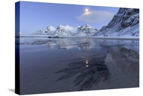 Full Moon Reflected in the Icy Sea around the Surreal Skagsanden Beach, Flakstad, Nordland County-Roberto Moiola-Stretched Canvas Print