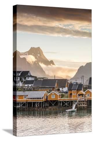 Sunset on the Fishing Village Framed by Rocky Peaks and Sea, Sakrisoya, Nordland County-Roberto Moiola-Stretched Canvas Print