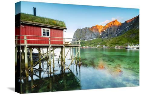 Typical House of Fishermen Called Rorbu Lit Up by Midnight Sun, Reine, Nordland County-Roberto Moiola-Stretched Canvas Print