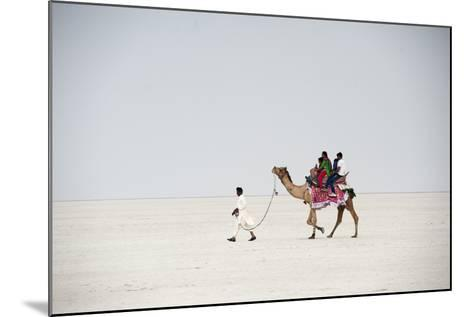 Indian Family Enjoying a Camel Ride in the White Desert-Annie Owen-Mounted Photographic Print