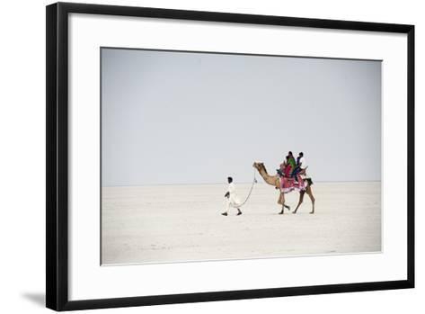 Indian Family Enjoying a Camel Ride in the White Desert-Annie Owen-Framed Art Print