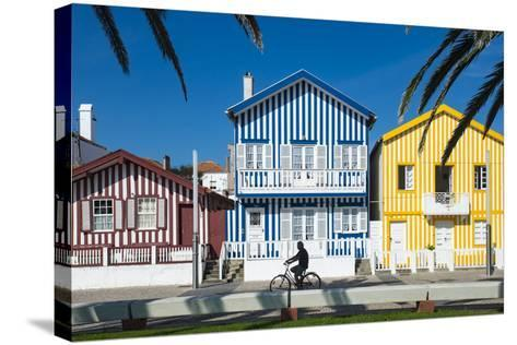 Colourful Stripes Decorate Traditional Beach House Style on Houses in Costa Nova, Portugal, Europe-Alex Treadway-Stretched Canvas Print