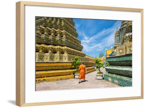 A Monk Walks Past Stupas at Wat Pho (Temple of the Reclining Buddha), Bangkok, Thailand-Jason Langley-Framed Art Print