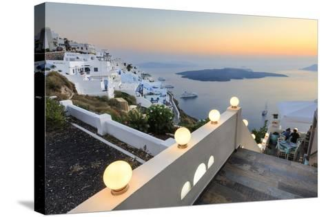 The Fiery Red Sky on the Aegean Sea after Sunset Seen from the Typical Terraces of Firostefani-Roberto Moiola-Stretched Canvas Print