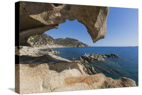 View of the Blue Sea from a Natural Sea Cave of Rocks Shaped by Wind, Punta Molentis, Villasimius-Roberto Moiola-Stretched Canvas Print