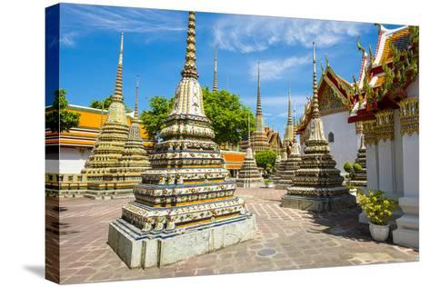 Stupas at Wat Pho (Temple of the Reclining Buddha), Bangkok, Thailand, Southeast Asia, Asia-Jason Langley-Stretched Canvas Print