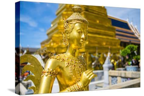 Kinnara Statue at Temple of the Emerald Buddha (Wat Phra Kaew), Grand Palace Complex, Bangkok-Jason Langley-Stretched Canvas Print
