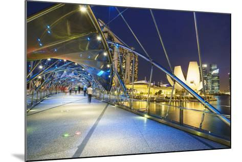 People Strolling on the Helix Bridge Towards the Marina Bay Sands and Artscience Museum at Night-Fraser Hall-Mounted Photographic Print