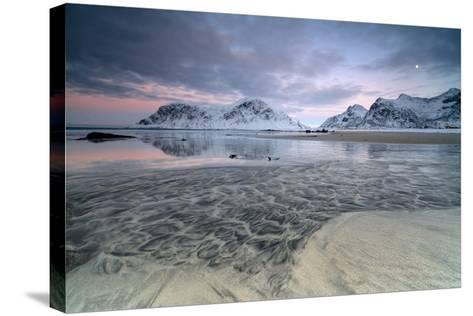 Black Sand and Full Moon as Surreal Scenery at Skagsanden Beach, Flakstad, Nordland County-Roberto Moiola-Stretched Canvas Print