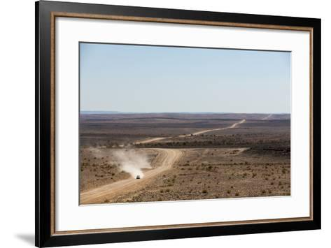 A Car Leaves a Cloud of Dust as it Apporachs Along the Long Dusty Road from the Fish River Canyon-Alex Treadway-Framed Art Print