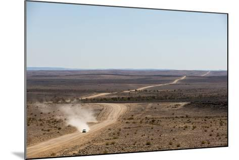 A Car Leaves a Cloud of Dust as it Apporachs Along the Long Dusty Road from the Fish River Canyon-Alex Treadway-Mounted Photographic Print