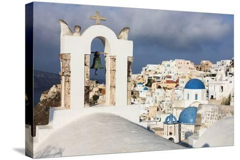 The White of the Church and Houses and the Blue of Aegean Sea as Symbols of Greece, Oia, Santorini-Roberto Moiola-Stretched Canvas Print