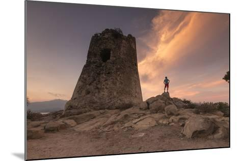 Hiker Admires Sunset from the Stone Tower Overlooking the Bay, Porto Giunco, Villasimius-Roberto Moiola-Mounted Photographic Print