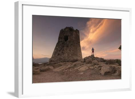 Hiker Admires Sunset from the Stone Tower Overlooking the Bay, Porto Giunco, Villasimius-Roberto Moiola-Framed Art Print