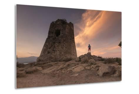 Hiker Admires Sunset from the Stone Tower Overlooking the Bay, Porto Giunco, Villasimius-Roberto Moiola-Metal Print