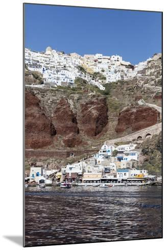 Typical Greek Village Perched on Volcanic Rock with White and Blue Houses and Windmills, Santorini-Roberto Moiola-Mounted Photographic Print