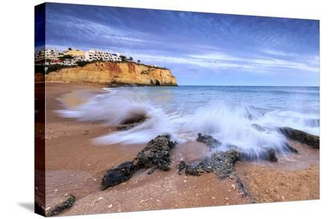 Ocean Waves Crashing on Rocks and Beach Surrounding Carvoeiro Village at Sunset, Lagoa Municipality-Roberto Moiola-Stretched Canvas Print