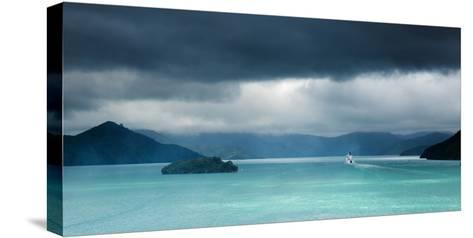 Queen Charlotte Sound with a Ferry Boat Navigating its Way Through to Cook Straits-Garry Ridsdale-Stretched Canvas Print