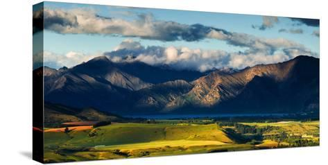 The Plains and Lakes of Otago Region Framed by Cloud Capped Mountains, Otago, South Island-Garry Ridsdale-Stretched Canvas Print
