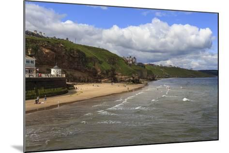 Bathers on West Cliff Beach, Backed by Grassy Cliffs in Summer, Whitby, North Yorkshire, England-Eleanor Scriven-Mounted Photographic Print