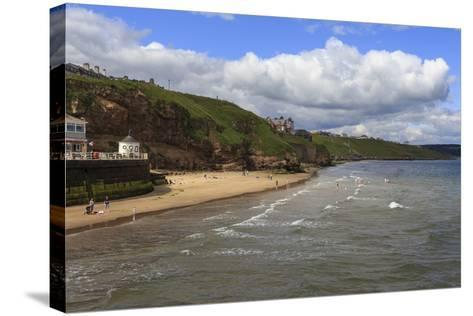 Bathers on West Cliff Beach, Backed by Grassy Cliffs in Summer, Whitby, North Yorkshire, England-Eleanor Scriven-Stretched Canvas Print