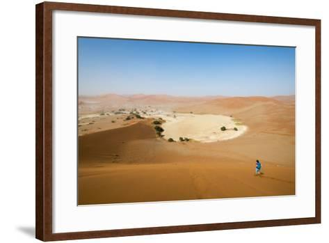 A Woman Runs Down from the Summit of Sossusvlei Sand Dune, Namibia, Africa-Alex Treadway-Framed Art Print