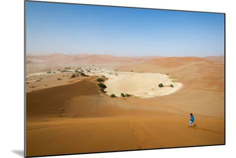 A Woman Runs Down from the Summit of Sossusvlei Sand Dune, Namibia, Africa-Alex Treadway-Mounted Photographic Print