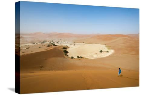 A Woman Runs Down from the Summit of Sossusvlei Sand Dune, Namibia, Africa-Alex Treadway-Stretched Canvas Print