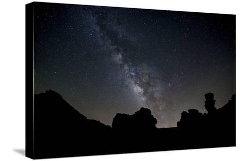 The Milky Way Arches High in the Night Sky Above Roques De Garcia in Teide National Park-Garry Ridsdale-Stretched Canvas Print