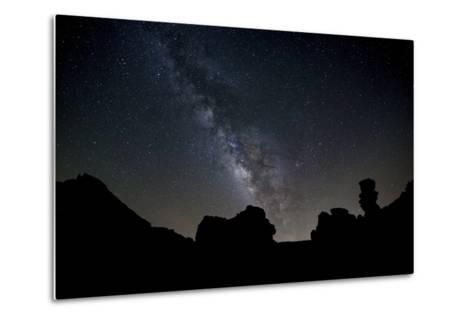 The Milky Way Arches High in the Night Sky Above Roques De Garcia in Teide National Park-Garry Ridsdale-Metal Print