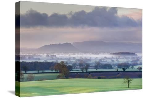 Low Winter Light Rakes across Cheshire Plain with Beeston Castle and Peckforton Sandstone Ridge-Garry Ridsdale-Stretched Canvas Print