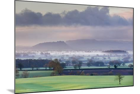 Low Winter Light Rakes across Cheshire Plain with Beeston Castle and Peckforton Sandstone Ridge-Garry Ridsdale-Mounted Photographic Print