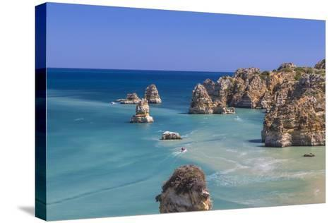 The Turquoise Water of the Atlantic Ocean and Cliffs Surrounding Praia Dona Ana Beach, Lagos-Roberto Moiola-Stretched Canvas Print