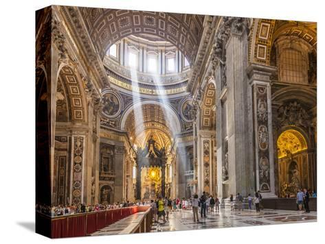 Interior of St. Peters Basilica with Light Shafts Coming Through the Dome Roof, Vatican City-Neale Clark-Stretched Canvas Print