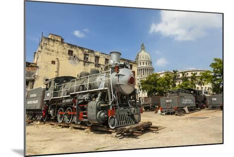 A Vintage Steam Train in a Restoration Yard with Dome of Former Parliament Building in Background-Sean Cooper-Mounted Photographic Print