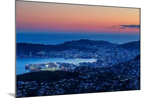 Overlooking the City of Wellington, its Harbour and Beyond to the Cook Straits at Dusk, Wellington-Garry Ridsdale-Mounted Photographic Print
