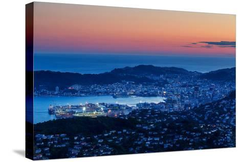 Overlooking the City of Wellington, its Harbour and Beyond to the Cook Straits at Dusk, Wellington-Garry Ridsdale-Stretched Canvas Print