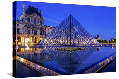 The Louvre Pyramid and Palace Reflected in a Still Pool Within the Napoleon Courtyard at Twilight-Garry Ridsdale-Stretched Canvas Print