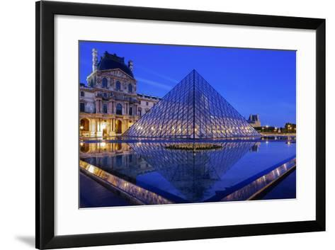 The Louvre Pyramid and Palace Reflected in a Still Pool Within the Napoleon Courtyard at Twilight-Garry Ridsdale-Framed Art Print